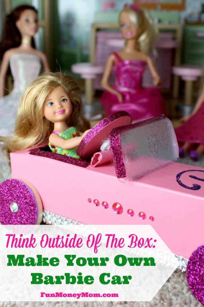 Barbie in car with other Barbies in the background