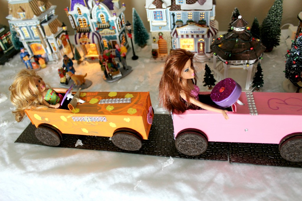 Barbie and friend zooming through town in their new Barbie cars