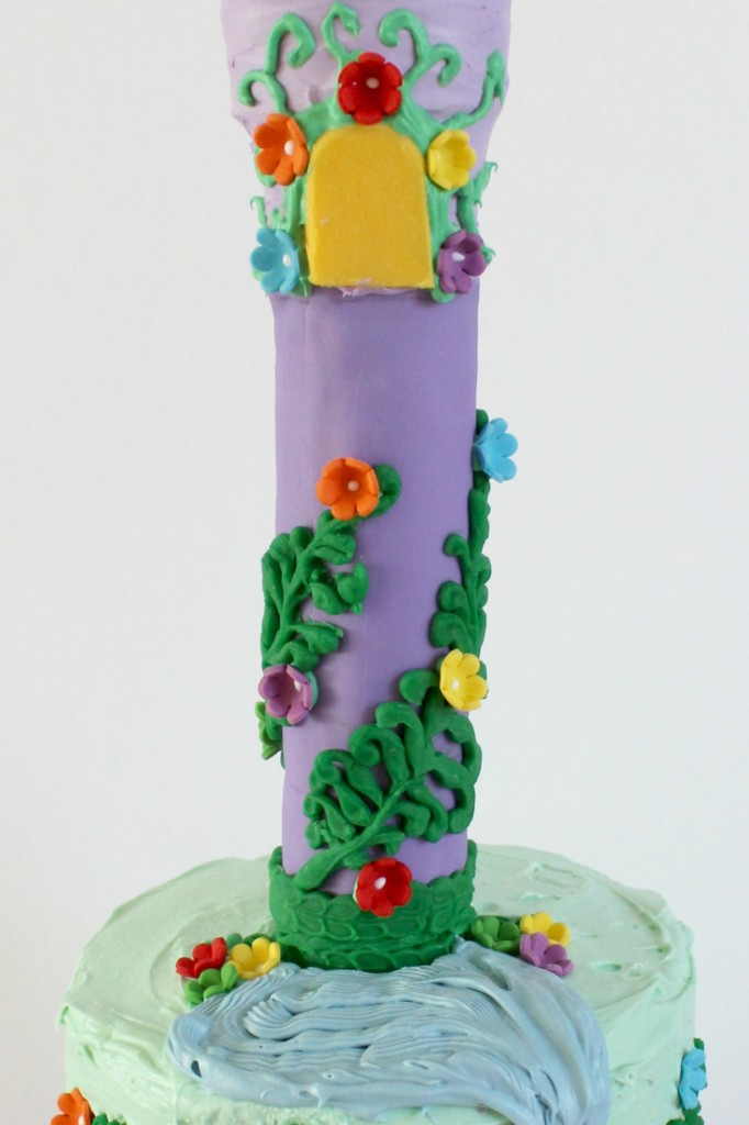 Wrap the Rapunzel cake tower with lots of greenery