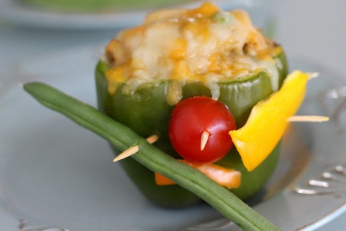 Keira's idea for decorating stuffed bell peppers was to just throw as much on as she could.