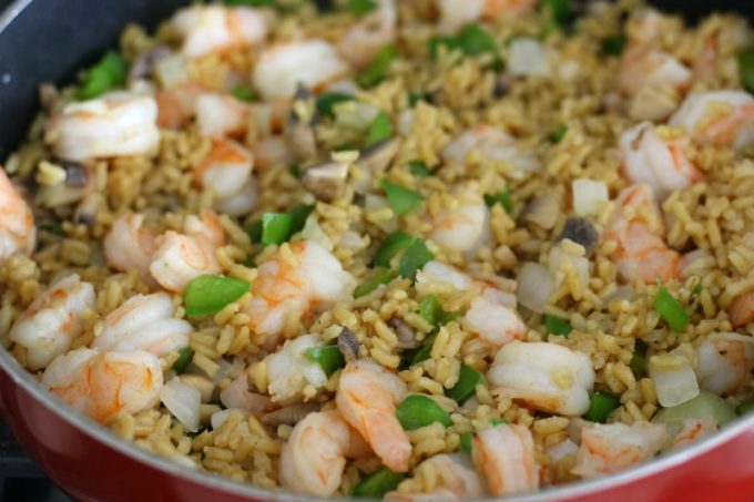 Once the shrimp, peppers and mushrooms are cooked, add the rice