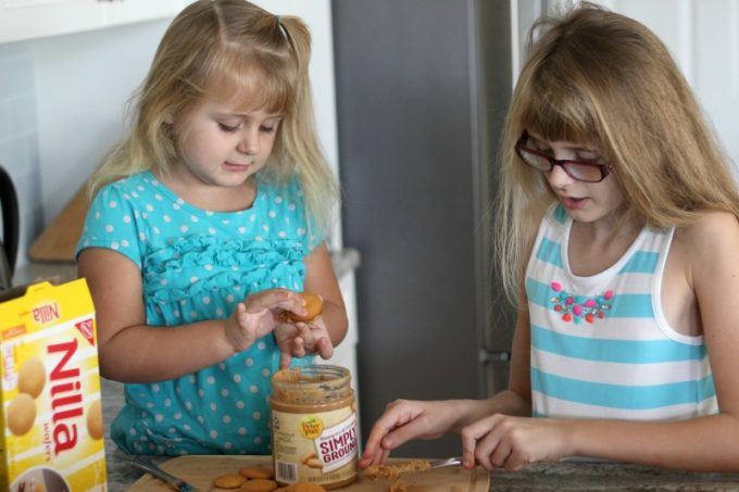 Kids making peanut butter Christmas cookies