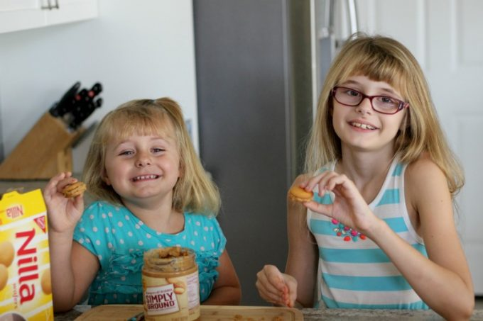 Girls holding Christmas cookies