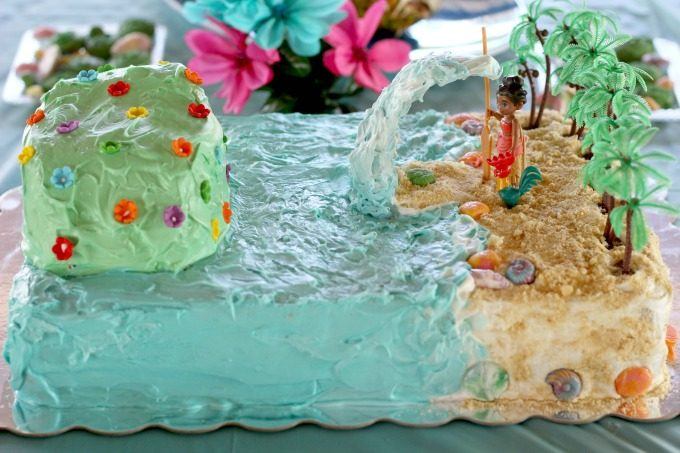 Surround the Moana birthday cake with flowers for a tropical island feel