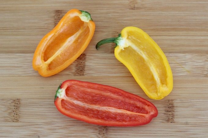 Cut the peppers lengthwise and scoop out the seeds