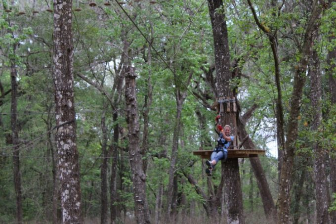 Have fun ziplining through the trees at Treehoppers in Pasco County