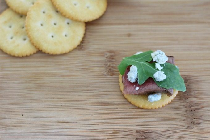 Blue cheese is a perfect addition to our party crackers with Steak, Blue Cheese and Arugula