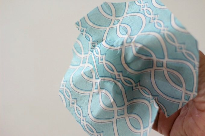 Place the napkin on the front and smooth it out for a pretty napkin wrapped Easter egg