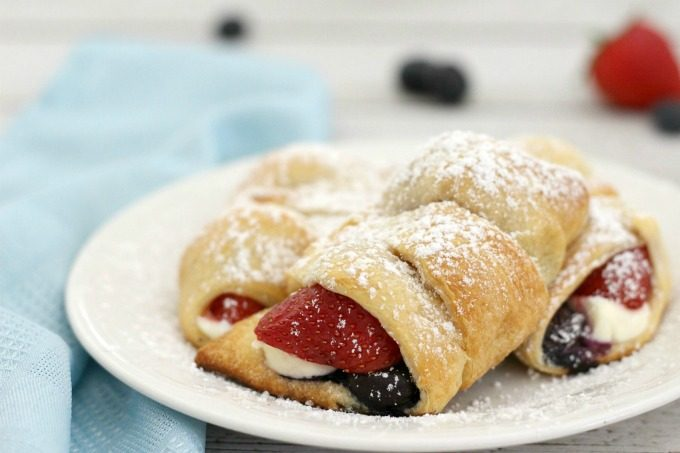 Sprinkle powdered suger over the Cheese and Berry Stuffed Crescent Rolls