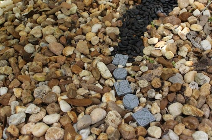 Stepping stones and black pebbles formed a path.