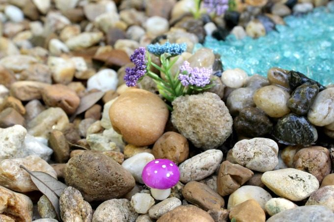 You can even add fake flowers and colorful mushrooms to brighten up the gnome garden
