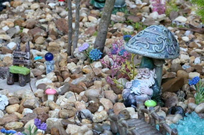 This guy is so comfy in his gnome garden that he's fallen asleep.