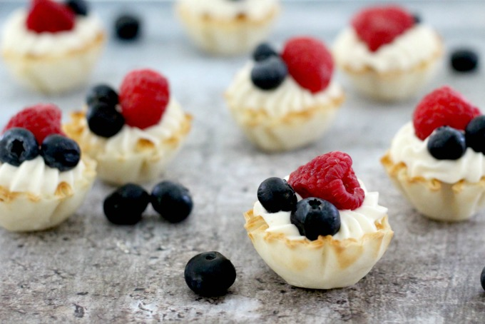 bite sized cheesecake desserts with fruit on top