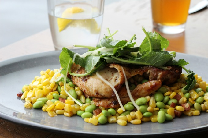 The half chicken comes with a bacon and corn succotash.