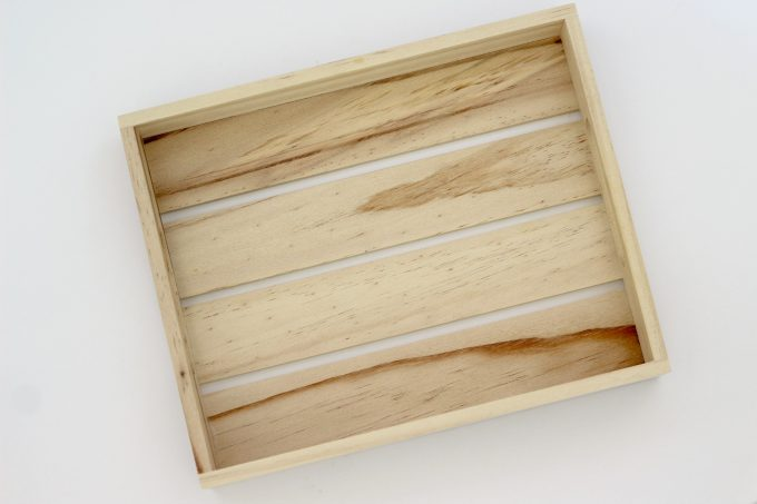 To make a coastal tray, you'll need just a plain wooden tray to start