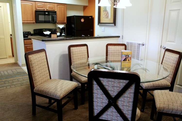 The dining room and kitchen at the Lake Buena Vista Resort Village And Spa