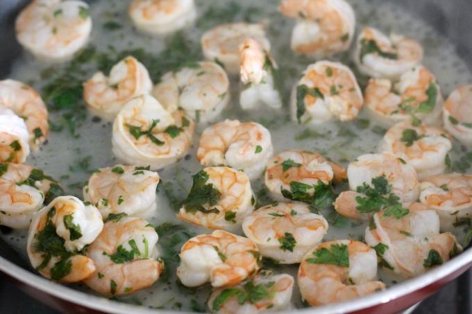Cook shrimp over medium heat.