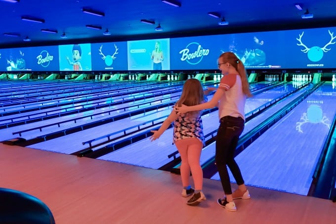 Getting bowling tips from big sister