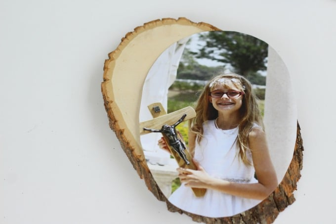 Cut the photo to fit just inside the wood.