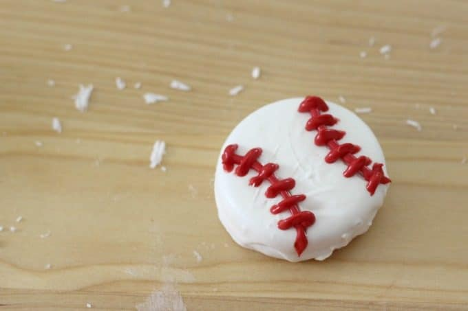 A little more red chocolate and your baseball cookies are finished