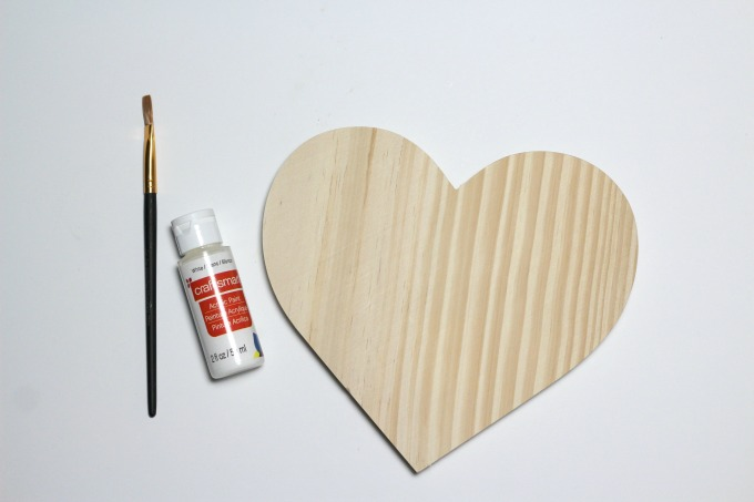 You can use a wooden heart to make easy DIY wall art.