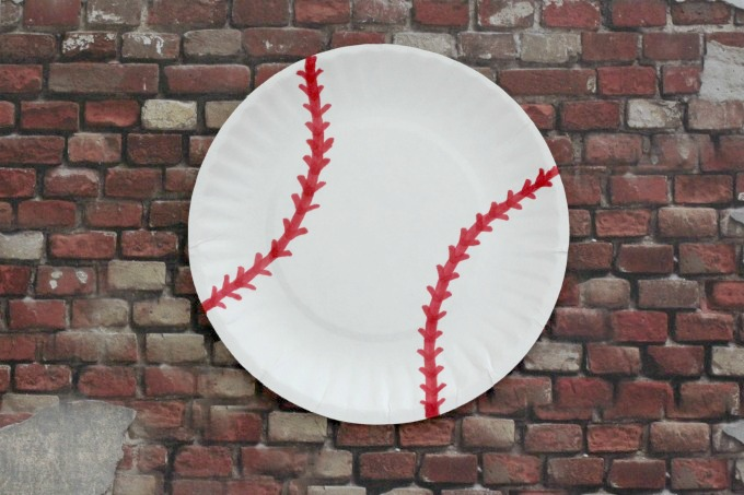 Add stitching to your paper plate baseball.