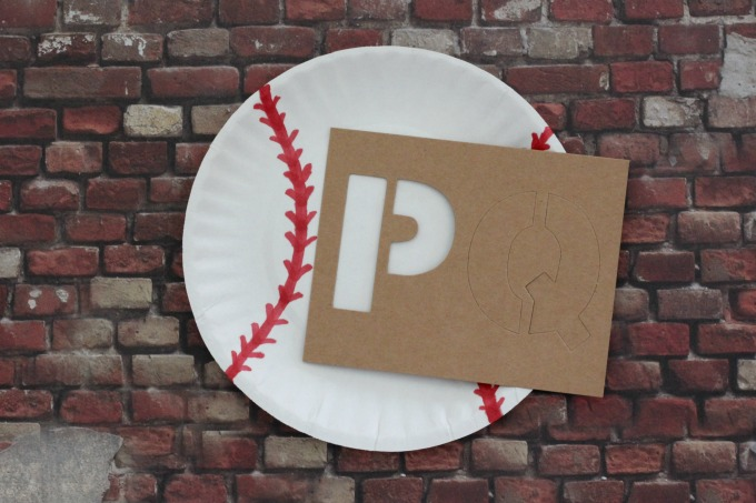 These paper plate baseballs are such easy baseball party decor.