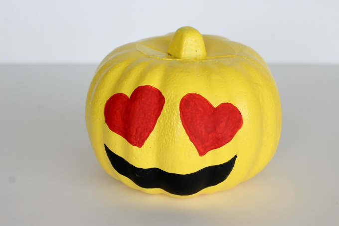 You can use paint or markers for your emoji pumpkins
