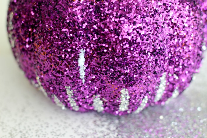 Sprinkle your glitter pumpkin with silver glitter