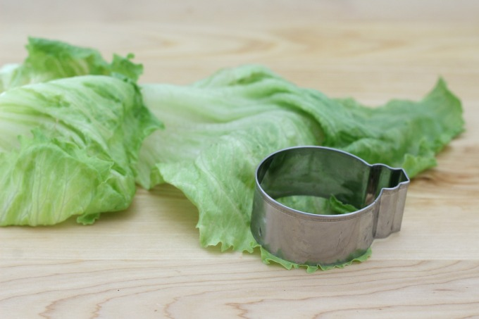 Use a cookie cutter to make round lettuce pieces for your mini veggie burger