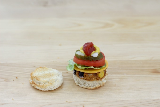 Top the mini veggie burger with ketchup and mustard