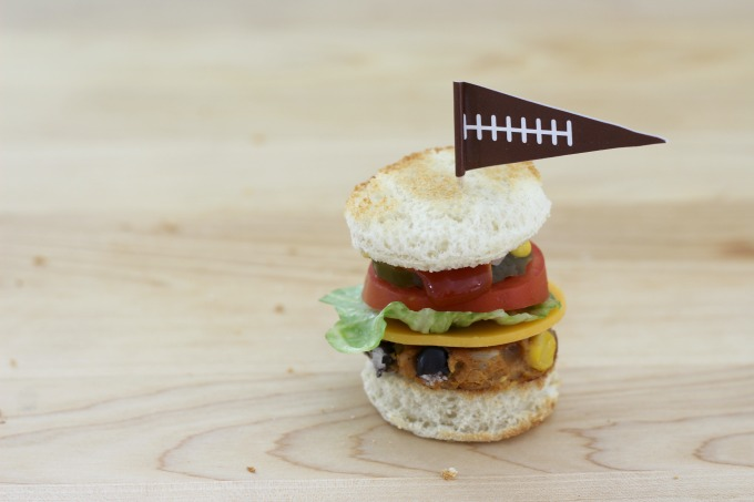 A football flag adds the finishing touch to your mini veggie burger