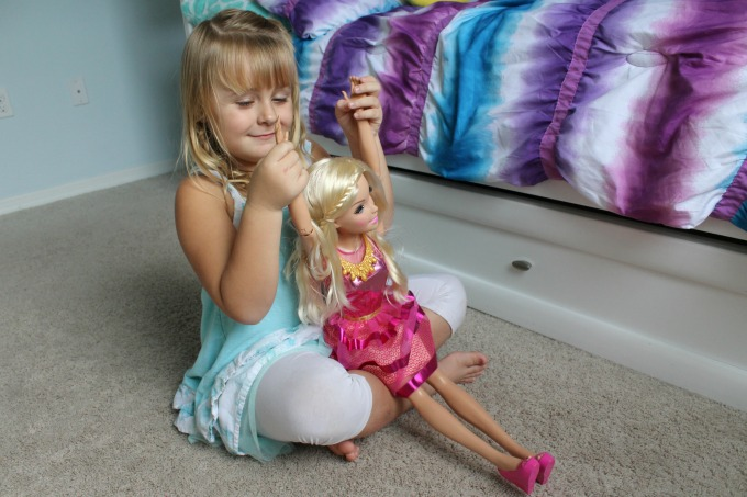 "My daughter loves posing with her 28"" Barbie doll"