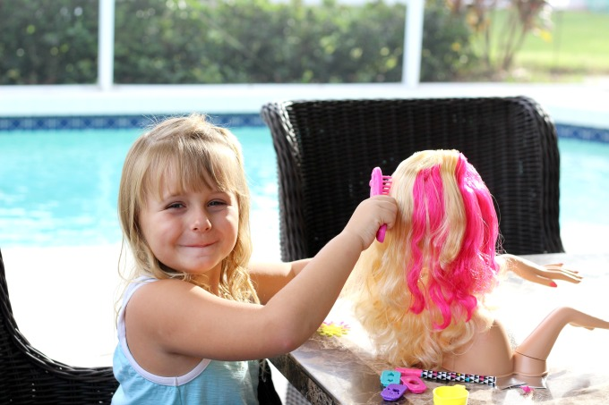 My daughter loved playing with this Barbie styling head