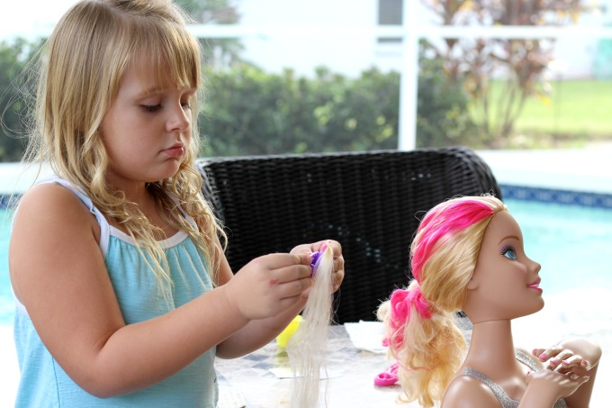 The Barbie styling head even comes with a hair extension