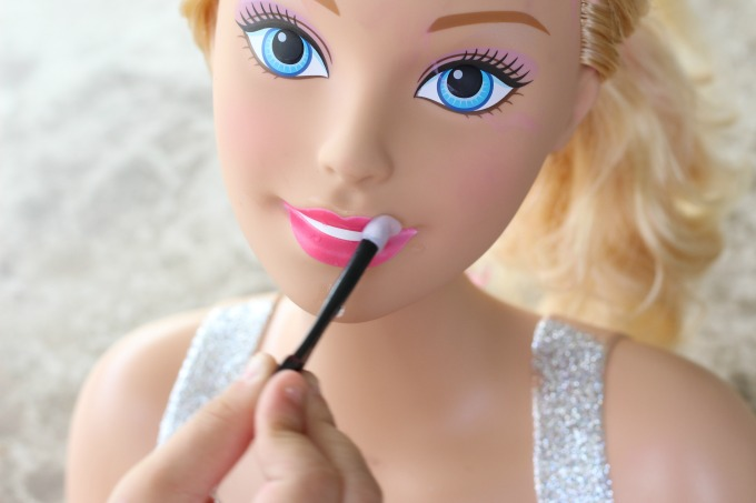 The lipstick on the Barbie styling head changes colors
