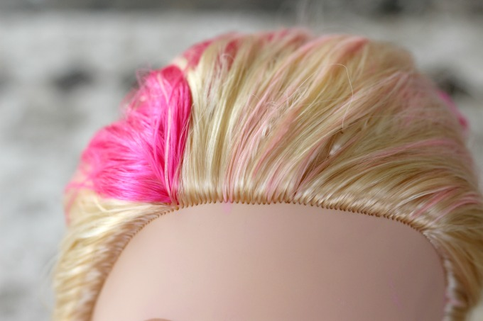Little girls can play hair stylist with their Barbie toys