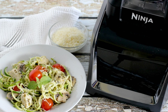 Use the Ninja Intelli-Sense Kitchen System with Auto-Spiralizer to make pesto zucchini noodles for the family