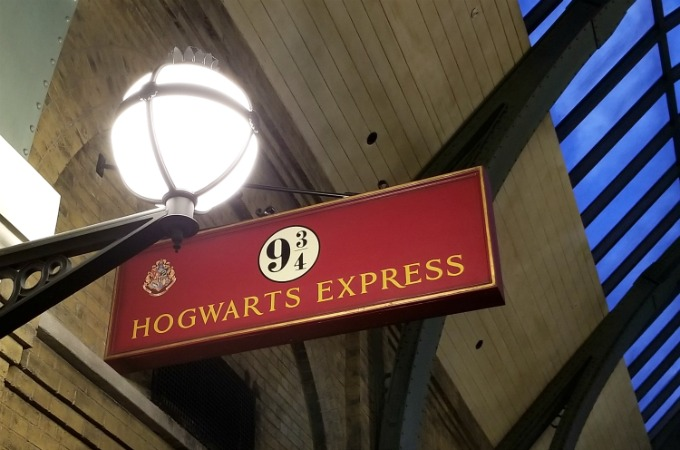 Harry Potter fans can walk through Platform 9 3/4 in the train station at The Wizarding World Of Harry Potter