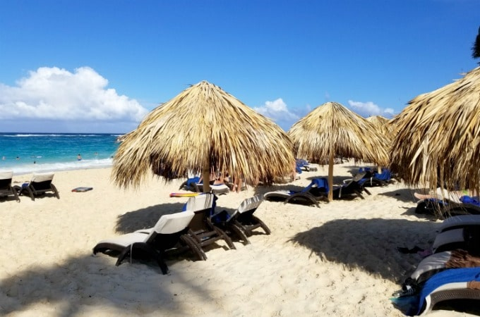 Relax under a thatched umbrella when you vacation at Memories Splash Punta Cana