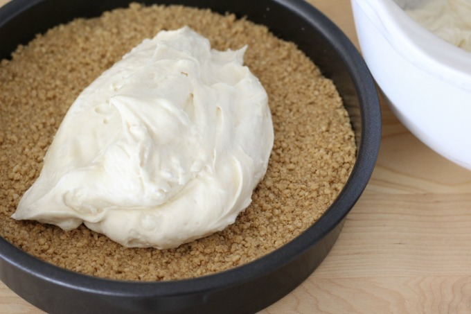 Fill the crust with the cheesecake mixture