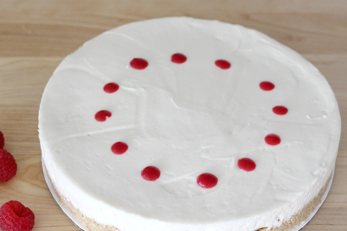 Squeeze dots of raspberry puree in a circle around the cake