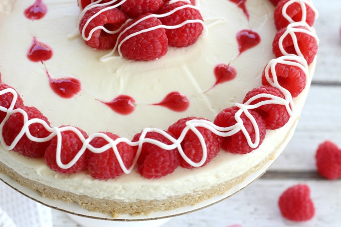 Drizzle chocolate over the raspberries and your white chocolate raspberry cheesecake is ready to serve.
