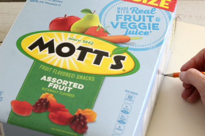 Trace around the outside edges of the Mott's Box