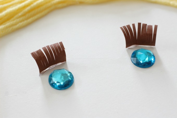 Fray brown paper and curl for the eyelashes
