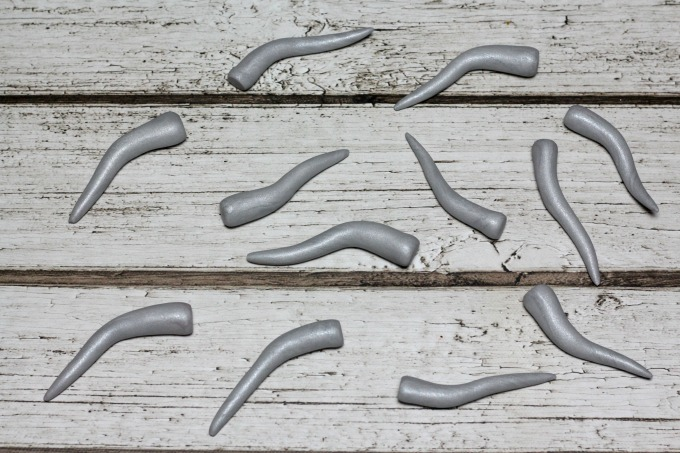 Bend pieces of silver or gray clay to make the Monster Book Of Monster horns