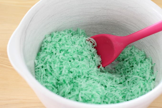 Mix the food coloring into the coconut