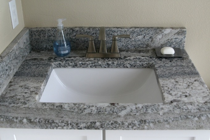 This sink could definitely use a coastal themed bathroom makeover