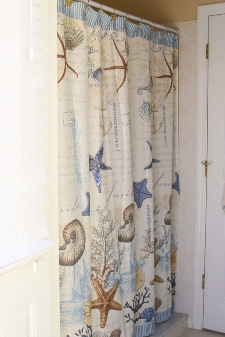 This pretty shower curtain is perfect for a coastal themed bathroom makeover