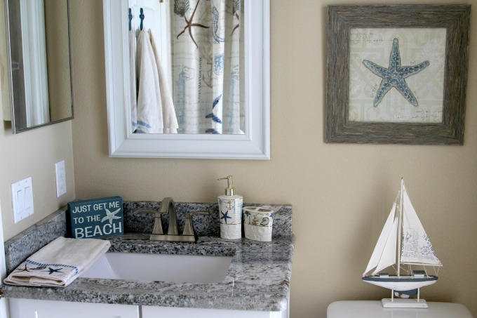 This coastal themed bathroom makeover looked great.
